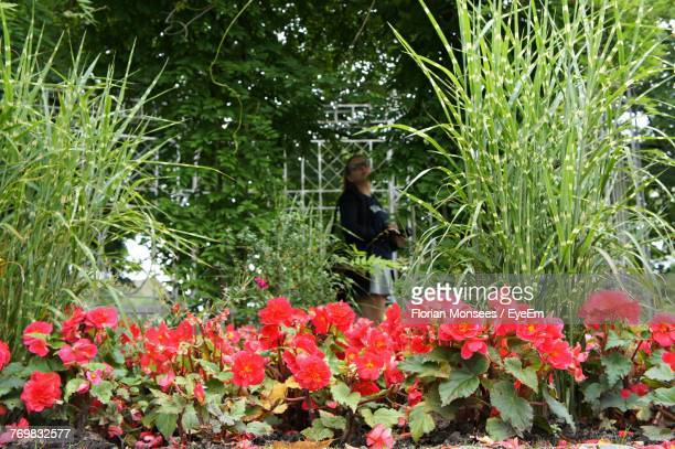 Young Woman Against Plants