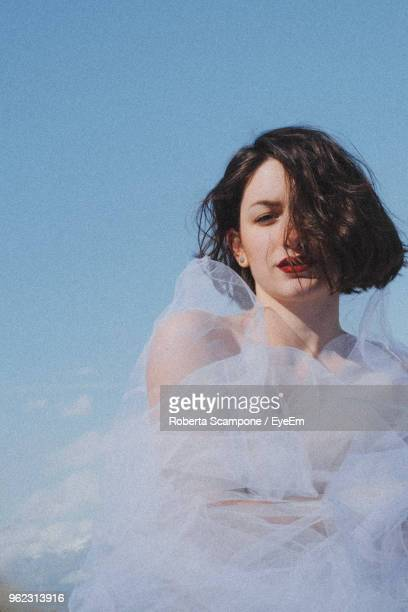 young woman against sky - tulle netting stock pictures, royalty-free photos & images