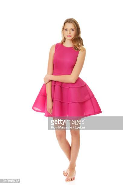 young woman against white background - pink dress stock photos and pictures