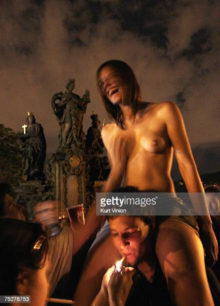 A young woman allows a man to touch her breasts during festivities for the official ceremony marking the 650th anniversary of the founding of...