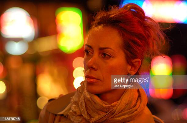 young woman alone in city at night - depczyk stock pictures, royalty-free photos & images