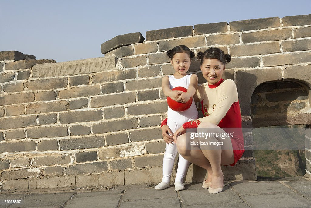 A young woman and a girl standing on the Great Wall of China. : Stock Photo