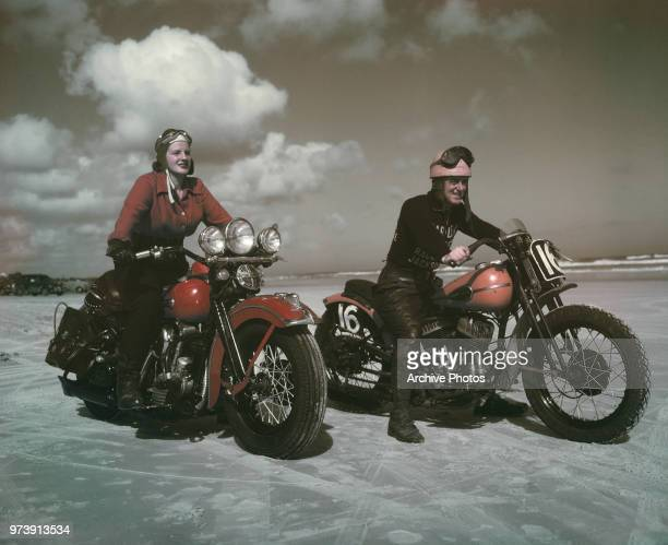 A young woman and a man with HarleyDavidson motorcycles possibly at Daytona Beach Florida circa 1948 The woman is astride a 1947 FL Knucklehead model...