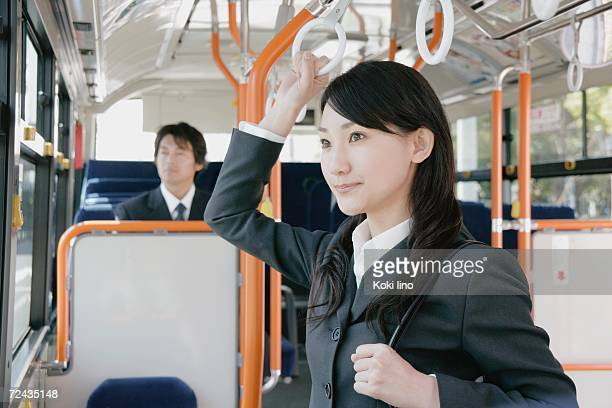 A young woman and a mid adult man in a bus