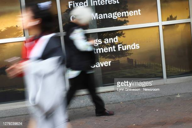 Young woman and an elderly woman walk past the offices of Forsyth Barr investment services on 7 October 2020. Rising house prices, housing shortages,...