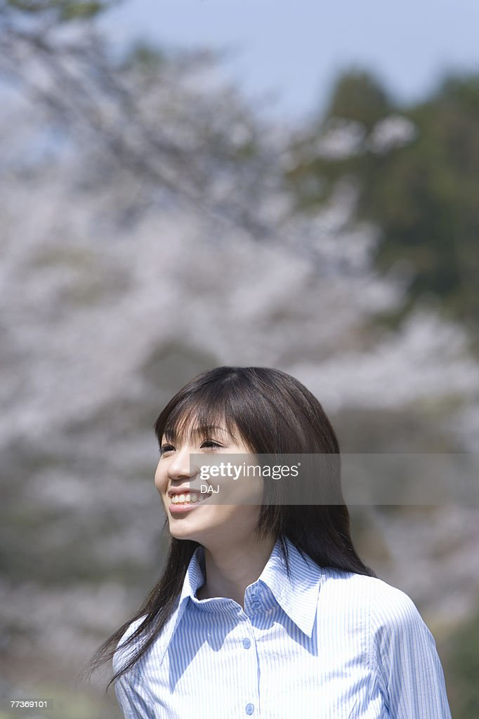 Young Woman and Cherry blossom, Differential Focus : Stock Photo