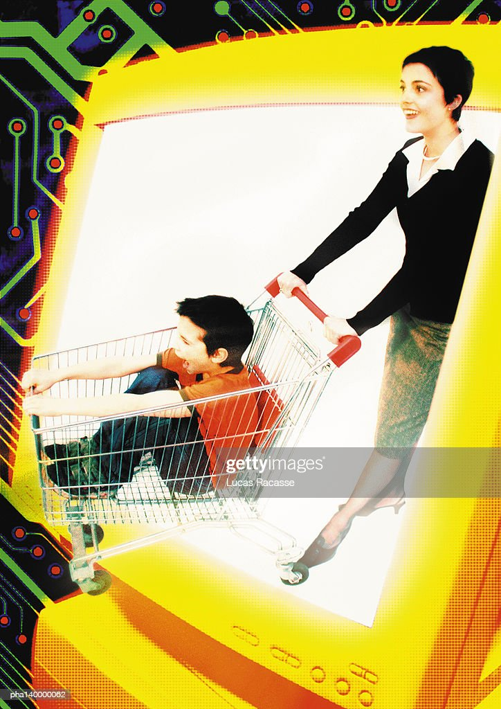 Young woman and child emerging from computer monitor, child in shopping cart, digital composite. : Stockfoto