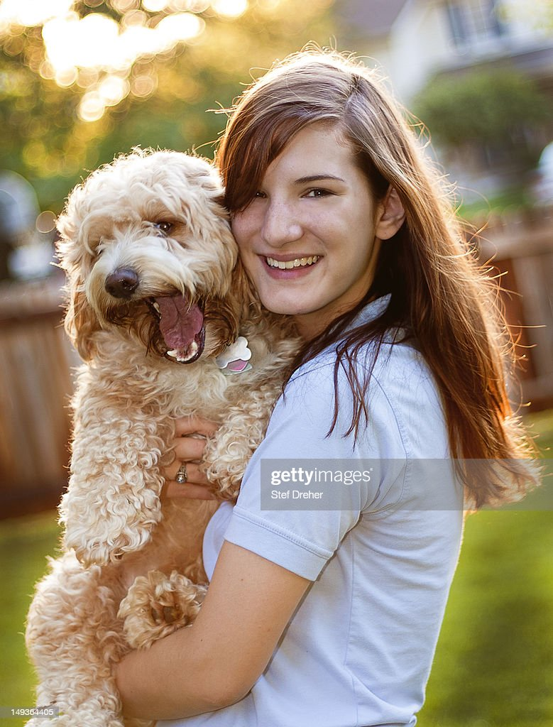Young woman and dog : Stock Photo