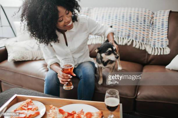 Young woman and dog sitting on a sofa