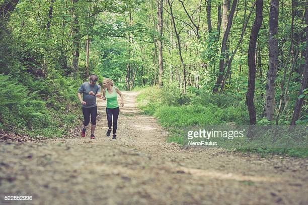 Young woman and elderly man running - time checking