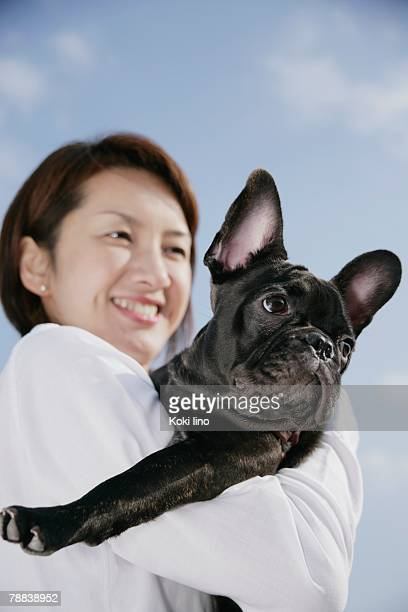 Young woman and French Bulldog