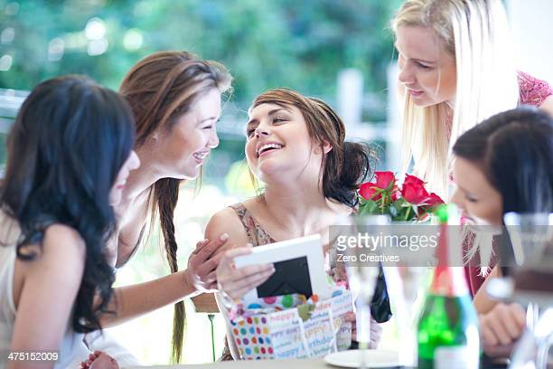 Young woman and friends with picture frame
