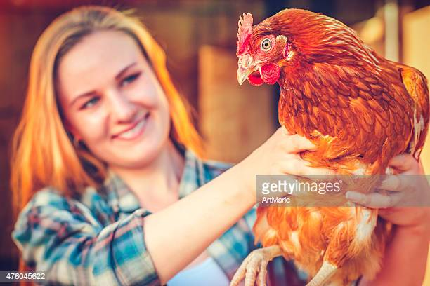 young woman and hen - livestock show stock pictures, royalty-free photos & images