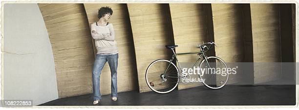 young woman and her bicycle - transfer image stock pictures, royalty-free photos & images