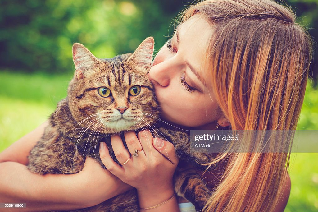 Young woman and her cat : Stock Photo
