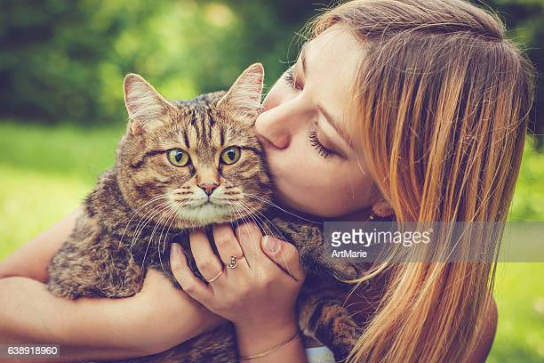 young woman and her cat - cats stock photos and pictures