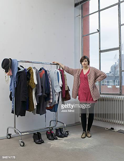 young woman and her clothes, portrait