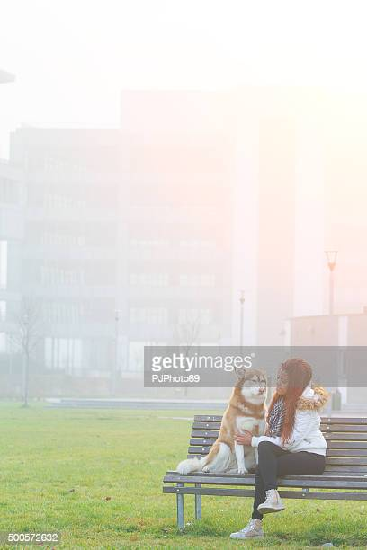 Young woman and her dog at park