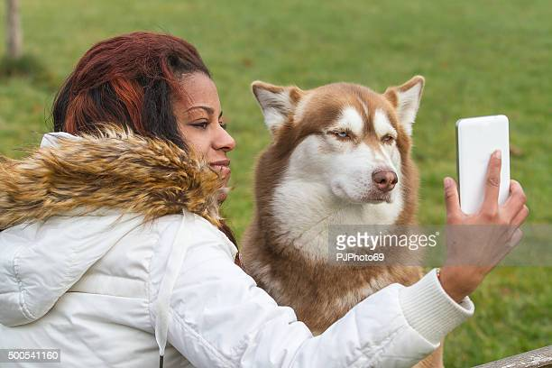 young woman and her dog doing selfie - pjphoto69 stock pictures, royalty-free photos & images