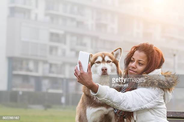 Young woman and her dog doing selfie