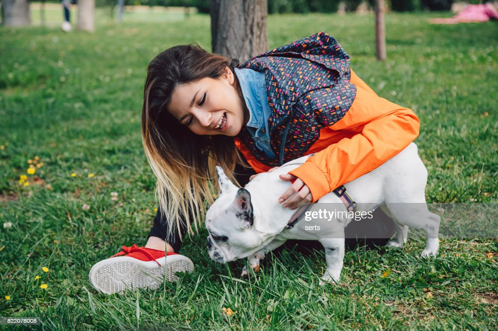 Young woman and her dog enjoying in the nature : Stock Photo