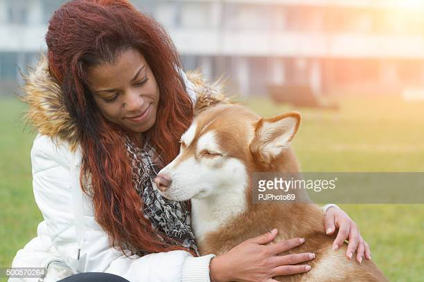 Young woman and her dog in urban park