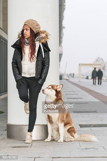young woman and her dog on the street - pjphoto69 stock pictures, royalty-free photos & images