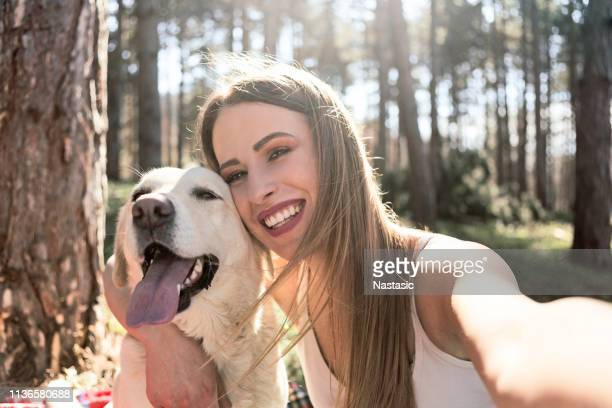 young woman and her golden retriever taking selfie - off leash dog park stock pictures, royalty-free photos & images