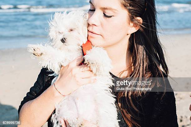 Young woman and her puppy