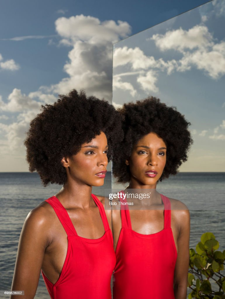 Young Woman And Her Reflection : Stock Photo