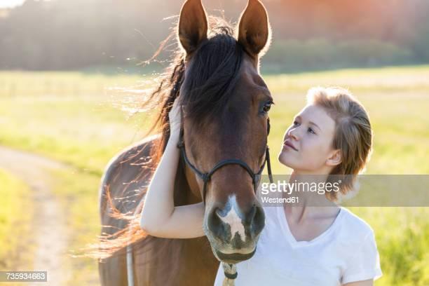 young woman and horse in nature - 1 woman 1 horse fotografías e imágenes de stock