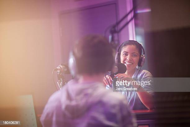 Young woman and man broadcasting in recording studio