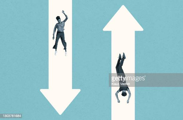 young woman and man falling over white arrows - black culture stock pictures, royalty-free photos & images