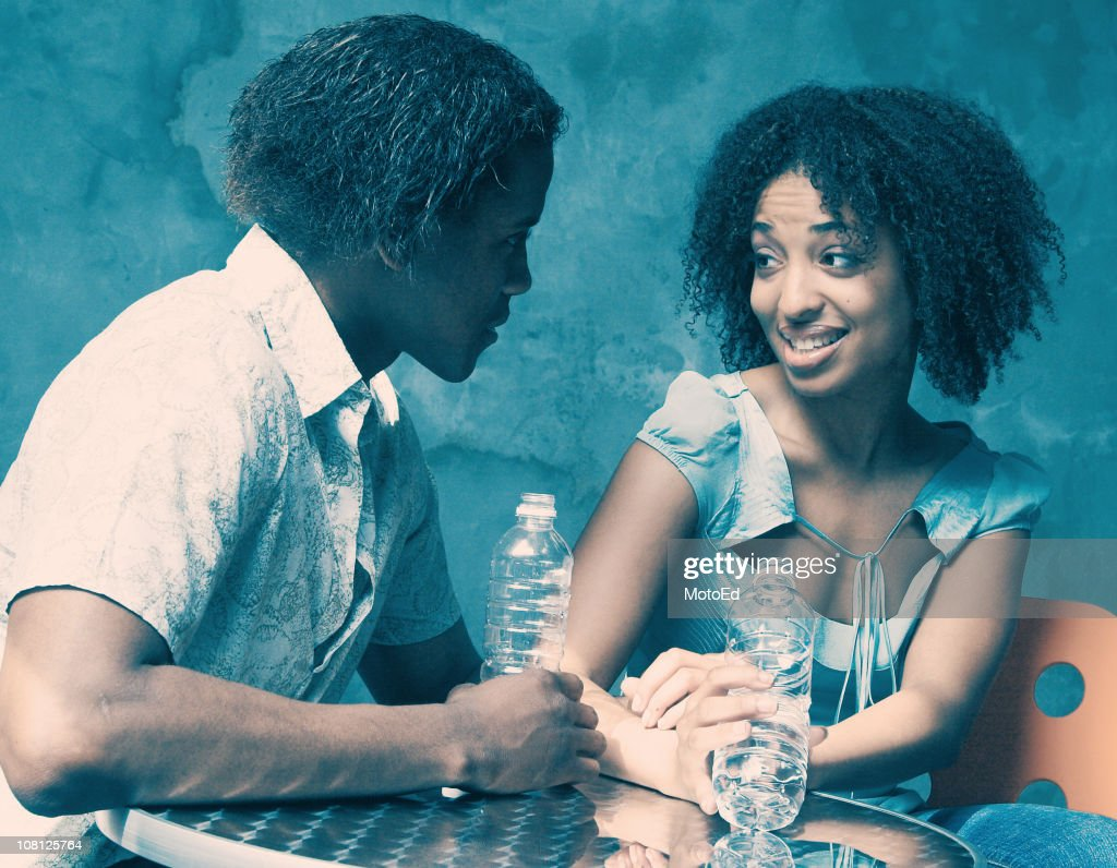 Young Woman and Man Flirting : Stock Photo