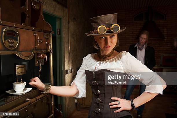 Young woman and man in steampunk stile make a coffee