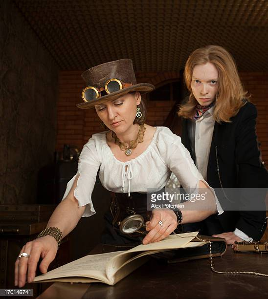 Young woman and man in vintage steampunk-style dressing