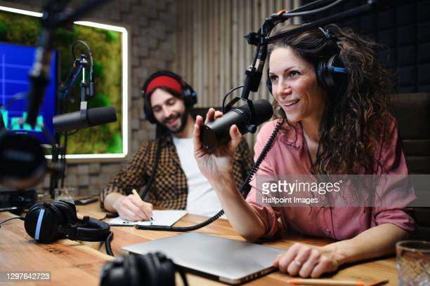 young woman and man makes a podcast audio recording in a studio. - radio stock pictures, royalty-free photos & images