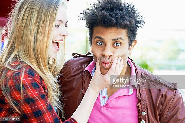 young woman and man making silly face to camera