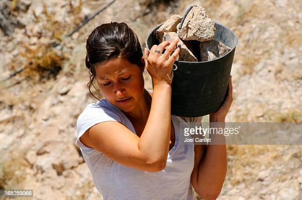 young woman and manual labor - extra long stock pictures, royalty-free photos & images