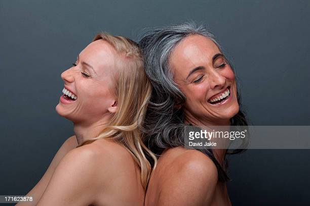 Young woman and mature woman laughing