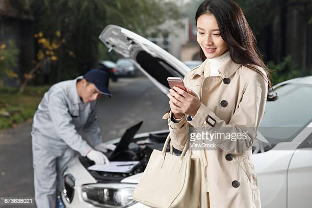 Young woman and mechanic