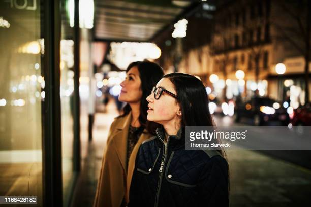 young woman and mother window shopping during holidays - trust stock pictures, royalty-free photos & images