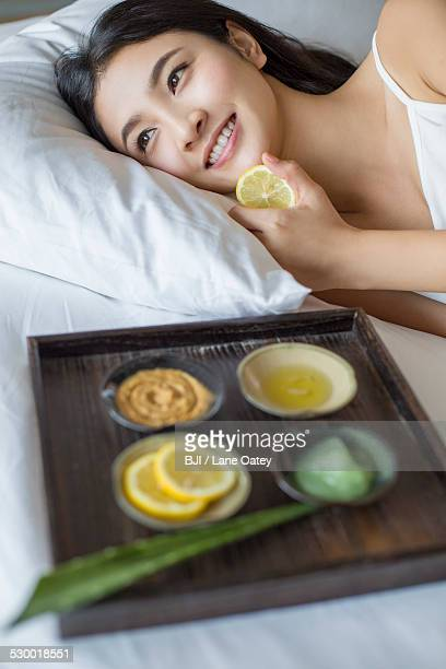 Young woman and natural facial mask