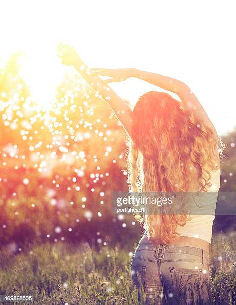Young woman and sunbeams