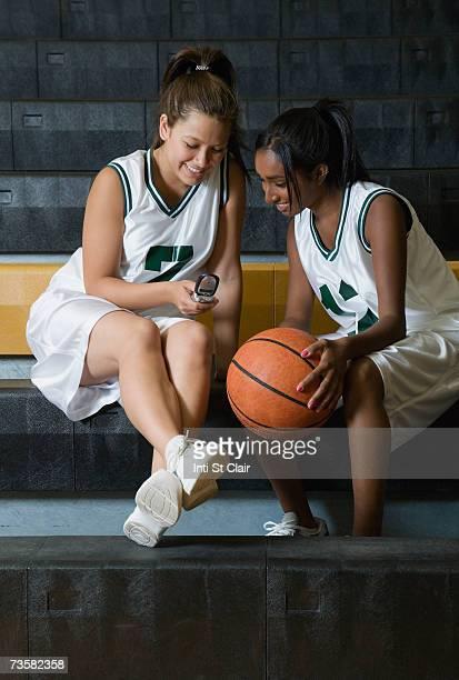 Teen girls wearing softball uniforms — 1