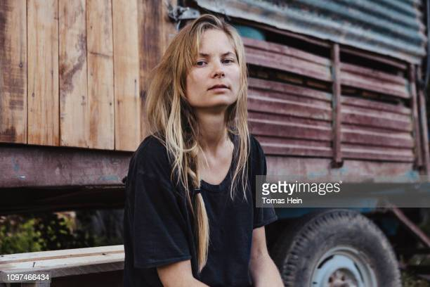 young woman and trailer - redneck woman stock photos and pictures