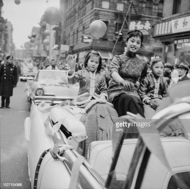 A young woman and two girls taking part in a beauty parade during Chinese New Year celebrations in Chinatown Manhattan New York City 28th January 1960