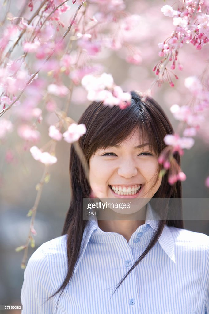 Young Woman and Weeping Cherry Trees, Differential Focus, Front View : Photo