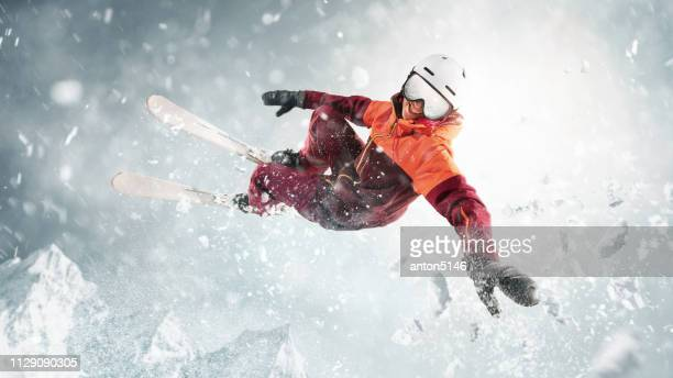 young woman and winter sport - she is skiing against white alps mountains - downhill skiing stock pictures, royalty-free photos & images