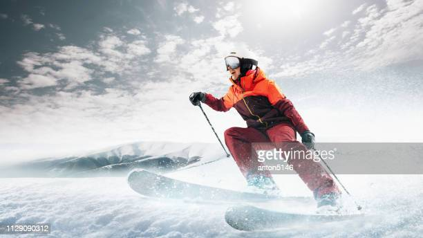 young woman and winter sport - she is skiing against white alps mountains - ski racing stock pictures, royalty-free photos & images